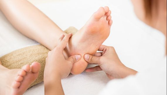 Someone having reflexology treatment